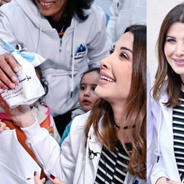 نانسي توزع الهدايا على الأطفال في أحياء مصر الفقيرة